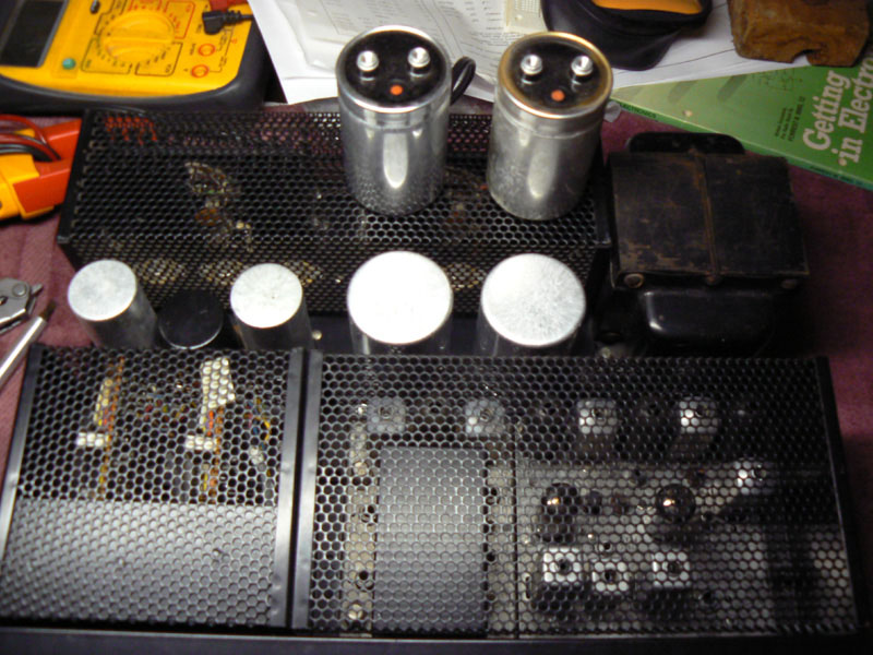 The two large screw-terminal type filter capacitors (new parts installed, old parts with terminals shown).